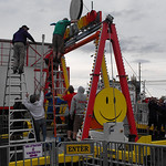 Workers repair the Happy Swing ride at Sheffield Lake Community Days set up at Shoreway Plaza on July 10 after storm damage.   Evan Goodenow photo