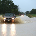 Drivers on West Road in Wellington brave the better than 2 inches of water covering the roads.