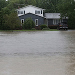 A home stands dry as rising waters on state Route 303 work closer and closer to the house. Many homes in that area were in danger of flooding.
