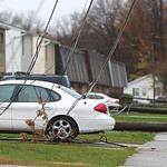 A line of poles all came down on on E.40th and Pearl in Lorain. High voltage lines draped across cars and the fronts of duplexes on the street.
