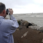 Scott Brosky, of Elyria, checks out the high waves at Lakeview Park in Lorain on Oct. 30.   Steve Manheim