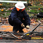Mike Sigurani, of Blue Jay Communications, works on fiber optic lines on Warden Ave. in Elyria on Oct. 30.   Steve manheim