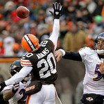 Baltimore Ravens quarterback Joe Flacco (5) throws a pass past leaping Cleveland Browns cornerback Mike Adams (20) in the second quarter of an NFL football game Sunday, Dec. 26, 2010, in Cle …