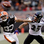 Baltimore Ravens cornerback Chris Carr (25) breaks up a pass for Cleveland Browns wide receiver Chansi Stuckey (83) in the third quarter of an NFL football game Sunday, Dec. 26, 2010, in Cle …