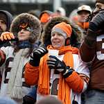 Cleveland Browns fans try to keep warm during an NFL football game between the Browns and the Baltimore Ravens, Sunday, Dec. 26, 2010, in Cleveland. The Ravens won 20-10. (AP Photo/Mark Dunc …