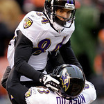 Baltimore Ravens wide receiver T.J. Houshmandzadeh, top, celebrates his 15-yard touchdown catch against the Cleveland Browns with tight end Ed Dickson in the second quarter of an NFL footbal …