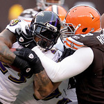 Baltimore Ravens running back Willis McGahee, left, is stopped by Cleveland Browns defensive lineman Derreck Robinson in the fourth quarter of an NFL football game Sunday, Dec. 26, 2010, in  …