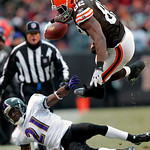 Cleveland Browns tight end Benjamin Watson (82) is tripped by Baltimore Ravens cornerback Lardarius Webb (21) after catching a pass in the fourth quarter of an NFL football game Sunday, Dec. …