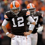 Cleveland Browns quarterback Colt McCoy (12) walks back to the huddle after throwing an incomplete pass against the Cleveland Browns late in the third quarter during their NFL football game  …