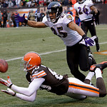 Cleveland Browns wide receiver Brian Robiskie, bottom, catches a 29-yard touchdown pass against Baltimore Ravens cornerback Chris Carr (25) in the first quarter of an NFL football game Sunda …