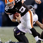 Cleveland Browns quarterback Colt McCoy (12) escapes a sack by Baltimore Ravens safety Dawan Landry in the fourth quarter of an NFL football game Sunday, Dec. 26, 2010, in Cleveland. McCoy p …