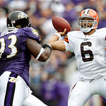Cleveland Browns quarterback Seneca Wallace passes as Baltimore Ravens defensive tackle Cory Redding closes in during the first half of an NFL football game in Baltimore, on Sunday, Sept. 26 …