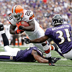 Cleveland Browns running back James Davis is stopped by Baltimore Ravens cornerback Fabian Washington, right, and another defender during the first half of an NFL football game in Baltimore  …