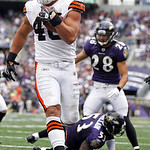 Cleveland Browns running back Peyton Hillis runs past Baltimore Ravens linebacker Jameel McClain, bottom, and safety Tom Zbikowski to score a touchdown during the first half of an NFL footba …