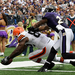 Cleveland Browns tight end Benjamin Watson crosses the goal line to score while being defended by Baltimore Ravens safety Dawan Landry, right, during the second half of an NFL football game, …
