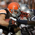 New England Patriots cornerback Devin McCourty (32) grabs for the ball on a run by Cleveland Browns running back Peyton Hillis in the first quarter of an NFL football game Sunday, Nov. 7, 20 …