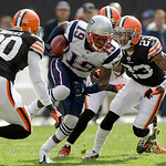New England Patriots wide receiver Brandon Tate (19) runs past Cleveland Browns defensive back Mike Adams (20) and cornerback Joe Haden (23) in the first quarter of an NFL football game Sund …