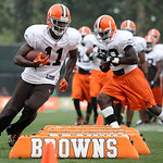 Cleveland Browns wide receiver Mohamed Massaquoi (11), running back James Davis, right, and others run a drill during the Browns NFL football training camp in Berea, Ohio on Wednesday, Aug.  …