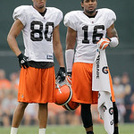 Cleveland Browns wide receivers Brian Robiskie (80) and Josh Cribbs watch from the sidelines during the Browns NFL football training camp in Berea, Ohio on Wednesday, Aug. 4, 2010.  (AP Phot …