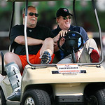 Cleveland Browns president Mike Holmgren, left, talks with NFL commissioner Roger Goodell in a golf cart as they watch the Browns practice at training camp Thursday, Aug. 5, 2010, in Berea,  …