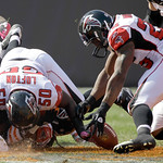Atlanta Falcons safety William Moore, right, picks up a fumble by Cleveland Browns running back Peyton Hillis in the first quarter of an NFL football game Sunday, Oct. 10, 2010, in Cleveland …