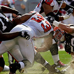 Cleveland Browns defensive tackle Ahtyba Rubin (71) and linebacker Matt Roth (53) tackle Atlanta Falcons running back Michael Turner in the first quarter of an NFL football game Sunday, Oct. …