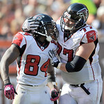 Atlanta Falcons wide receiver Roddy White (84) is congratulated by offensive tackle Tyson Clabo (77) after White caught a 45-yard touchdown pass from quarterback Matt Ryan against the Clevel …