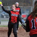 Elyria pitcher Alyssa Barker makes a put out throw to Patty Davis on Apr. 17.  Steve Manheim