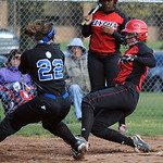 Elyria's Melanie Woodard slides safe before the tag by Brunswick 22 Briana Bentler to score on a wild pitch in the first inning on Apr. 11.  Steve Manheim