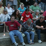 "Kat's dad Ken (in red) and mother Jane (sitting next to Ken) attend a heart-warming turnout for their daughter.  The candlelight vigil was held to remember Catherine ""Kat' Hoholski at Vetera …"