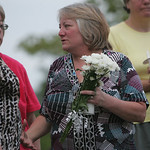 Jane Hoholski receives condolences from those attending a candlelight vigil for Catherine 'Kat' Hoholski.  photo by Chuck Humel