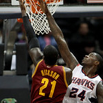 Cleveland Cavaliers forward J.J. Hickson (21) puts in a basket past the reach of Atlanta Hawks forward Marvin Williams (24) during the second quarter of an NBA basketball game Wednesday, Dec …