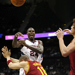 Atlanta Hawks forward Marvin Williams (24) loses the ball while defended by Cleveland Cavaliers guard Anthony Parker (18) and forward Anderson Varejao, right, of Brazil, during the second qu …