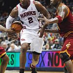 Atlanta Hawks guard Joe Johnson (2) loses the ball behind his back while dribbling against Cleveland Cavaliers forward Antawn Jamison, right, during the first quarter of an NBA basketball ga …