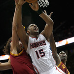 Atlanta Hawks center Al Horford (15) goes up for a shot against Cleveland Cavaliers forwards Anderson Varejao, left, and Antawn Jamison, right, during the first quarter of an NBA basketball  …