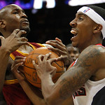 Atlanta Hawks guard Jeff Teague, right, and Cleveland Cavaliers forward Jawad Williams struggle for a loose ball during the fourth quarter of an NBA basketball game Wednesday, Dec. 22, 2010, …
