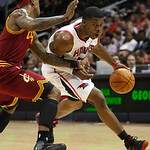 Atlanta Hawks guard Joe Johnson, right, dribbles around Cleveland Cavaliers guard Daniel Gibson during the first quarter of an NBA basketball game Wednesday, Dec. 22, 2010, in Atlanta. Atlan …