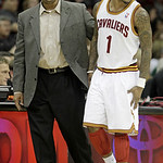 Cleveland Cavaliers' Daniel Gibson, right, grimaces as he is walked off the court by athletic trainer Max Benton in the third quarter of an NBA basketball game Wednesday, Jan. 5, 2011, in Cl …