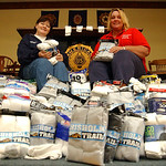 Carol Knapp, left, president of American Legion Auxiliary Post 12, and Johni Wressell,  1st vice-president, sit among sock donations for the homeless, donated by Vermilion AMVETS Post 22, Oc …
