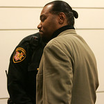 18NOV09  Former Lorain County Commissioner Michael Ross gets hand-cuffed after being found guilty for soliciting bribes involving the construction of the Lorain County Justice Center.   phot …