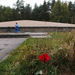 FILE – In this photo taken Oct. 11, 2003 visitors to the former World War II Nazi death camp of Sobibor, eastern Poland, walk along the mound formed by human ashes. John Demjanjuk goes on tr …
