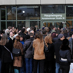 Visitors and journalists wait in front of the entrance of the country court building in Munich, southern Germany, prior to the first day of the Demjanjuk trial, Monday, Nov. 30, 2009. John D …