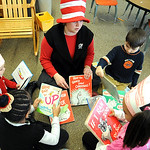 Lisa Ward, first grade teacher, reads with her students, clockwise from bottom right, Telyce Matthews, Kamia Pilson, Sophia Brown-White and Donovan Wolfe, at a Dr. Suess Birthday celebration …