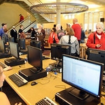 People walk through the media center on a tour of the new Elyria High Oct. 22.  Steve Manheim