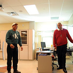 Jammel Dickerson, principal of team III at Elyria High, shows a classroom on a tour of the new Elyria High Oct. 22.   Steve Manheim