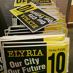 3NOV09  Issue 10 signs, duly collected from tree lawns, are stacked outside of the Knights of Columbus hall where backers gathered to hear the ultimate results–a 59 to 40 point defeat.  [do …