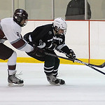 EC 11 Collin Lester and Rocky River Kyle Kopecheck go after puck Jan. 17.  Steve Manheim