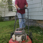Tom Lahetta, 55, of South Amherst mows a lawn on South Maple Street iin Elyria.