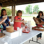 Mary Gross, Kim Benetto and Celeste Brlas serve strawberry shortcakes to Linda Blackwell and David Howard at the Strawberry Festival on Wednesday. KRISTIN BAUER | CHRONICLE