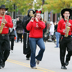 Members of the Elyria High School Alumni Marching Band play for a crowd lining Broad Street. ANNA NORRIS/CHRONICLE
